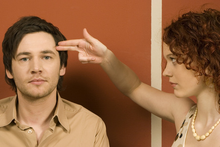 Woman Holding Fingers On Had Of Man