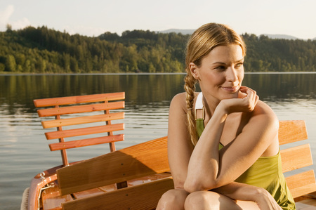 Woman At Lake, Sitting In Rowing Boat