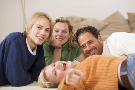 Family Lying On Floor In Living Room