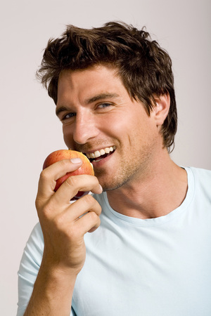 Young Man Holding Apple,Portrait