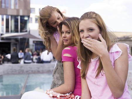 Three Teenage Girls, Wisphering LANG_EVOIMAGES