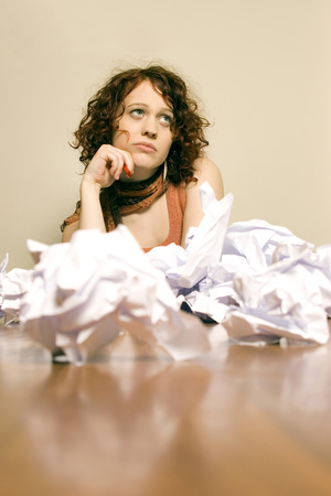 critical thinking: Young Woman With Crumpled Paper