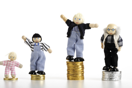 Figurines Standing On Piles Of Coins