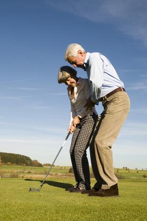 Germany, Bavaria, Senior Couple Playing Golf