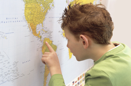 enquiring: Boy (8-9) Looking At World Map, Close-Up