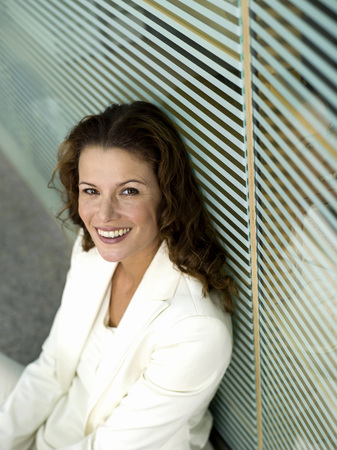Businesswoman Sitting On Floor, Smiling, Elevated View, Portrait