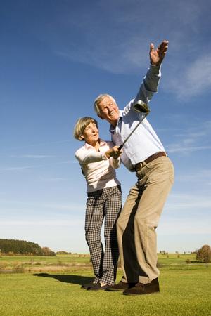 common goal: Germany, Bavaria, Senior Couple Playing Golf