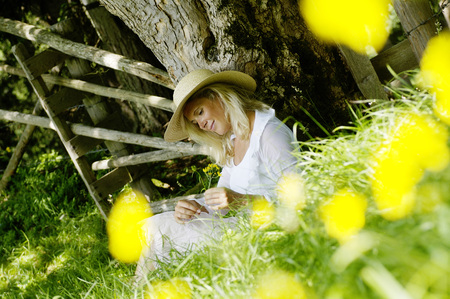 Young Woman Relaxing Under Tree