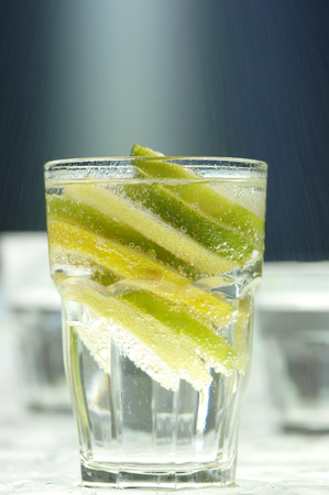 citrons: Lemon And Lome Slices In Glass Of Water