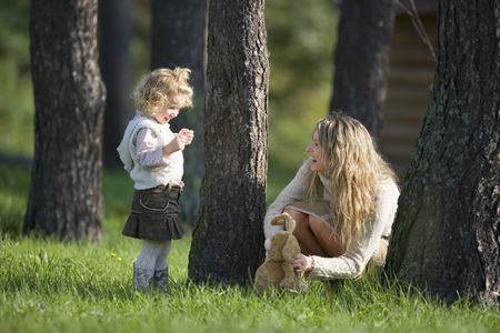 Mother Playing With Daughter In Wood