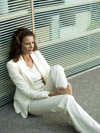 Businesswomn Sitting On Floor, Portrait