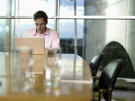 Young Man In Office, Working At Laptop