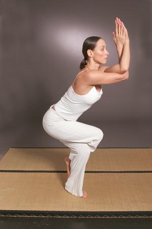 body consciousness: Woman Exercising Yoga, The Eagle Exercise
