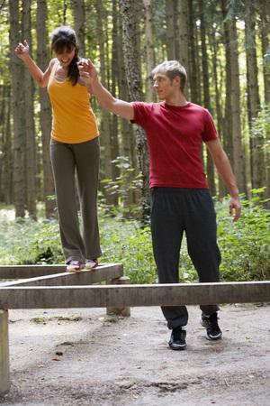 Young Couple Balancing On Bars