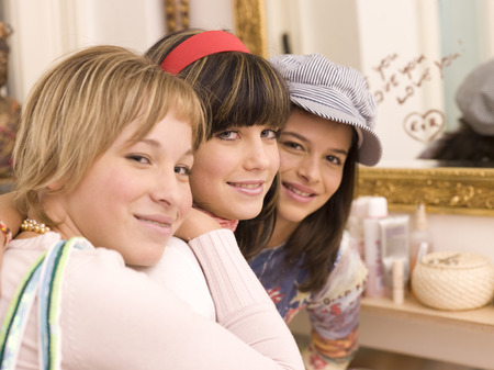 Three Girl Friends Looking To Camera, Smiling, Portrait LANG_EVOIMAGES