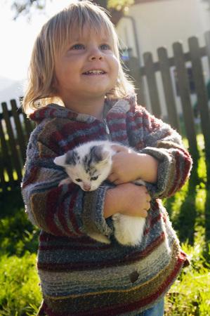 Boy Holding Kitten, Portrait