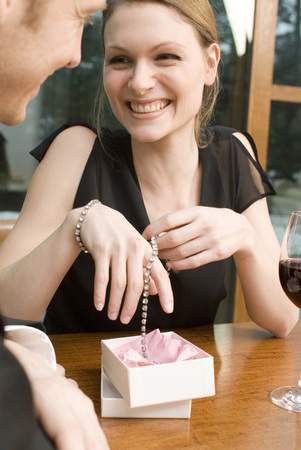 Woman Rejoicing Over Jewellery