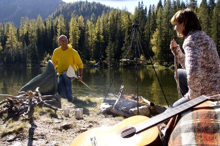 Man And Woman Camping At Lake