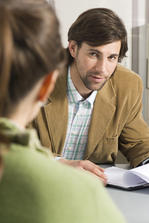 Business Colleague Discussing In Office, Focus On Man In Background