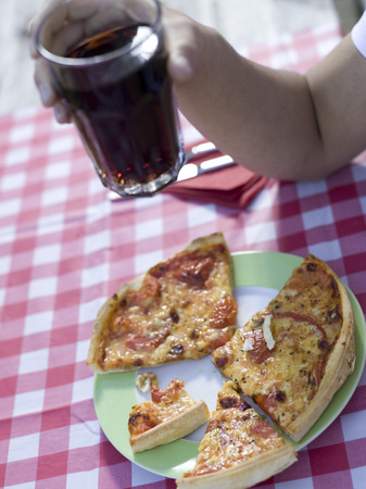 Pizza On Plate, Young Man Holding Glass LANG_EVOIMAGES