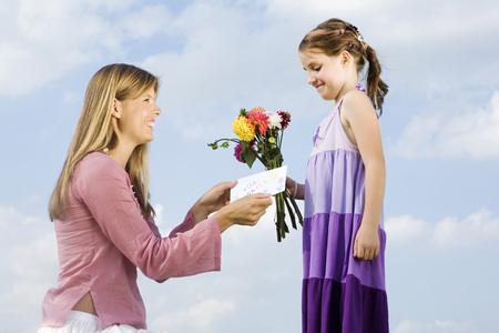 Mother And Daughter, Girl Holding Bunch Of Flowers