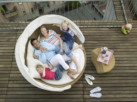 Familiy On Sofa, Out Doors