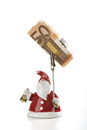 give out: Santa Claus Figurine Holding Euro Note LANG_EVOIMAGES