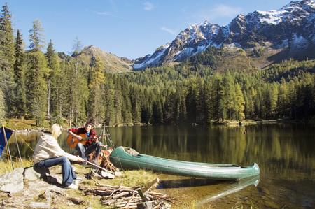 Young Couple Camping At Lake