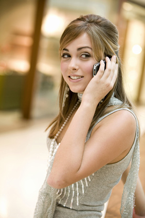 Young Woman Using Mobile Phone, Portrait
