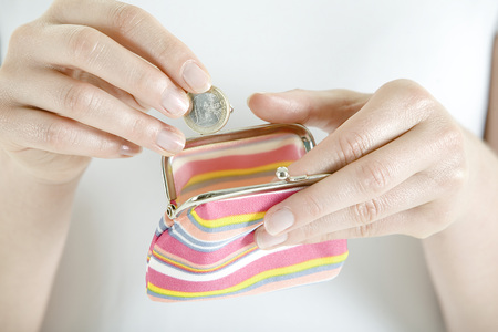 Woman With Change Purse, Close-Up LANG_EVOIMAGES