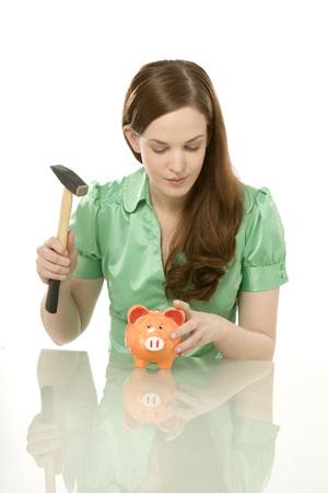 Young Woman Breaking Piggy Bank, Portrait