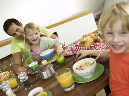 Father And Children At Breakfast Table