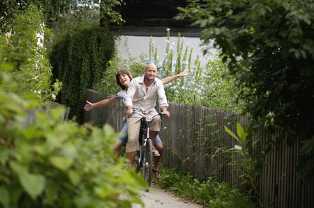 jubilating: Couple Riding Bicycle