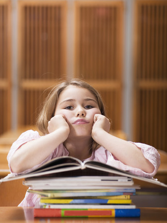 in low spirits: Girl (4-7) Sitting Desk, Leaning On Stack Of Books, Portrait
