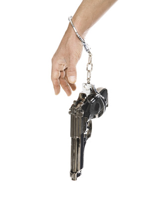Pistol Hanging On Arm, Close-Up LANG_EVOIMAGES