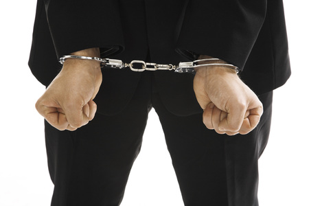 Man Wearing Handcuffs, Close-Up LANG_EVOIMAGES
