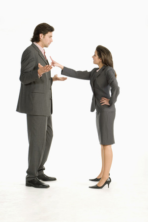 Businessman And Businesswoman Discussing, Side View