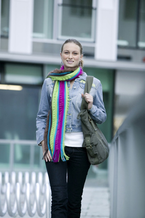 Young Woman Wearing Scarf, Walking LANG_EVOIMAGES