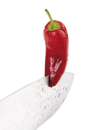 Knife Blade Cutting Through Red Pepper, Close-Up