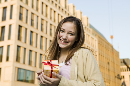 Young Woman, Holding Gift LANG_EVOIMAGES
