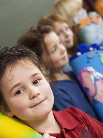 Children (4-7) Holding School Cone, Close-Up, Tilt View