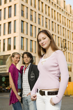 Young Woman In Street, Young Couple In Background