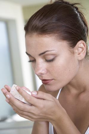 Woman Smelling Soap