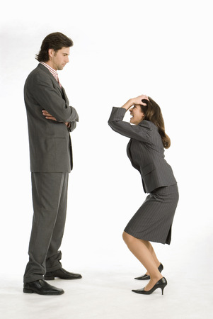 Businesswoman Laughing At Businessman, Side View