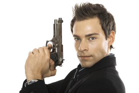 Young Man Holding Hand Gun, Close-Up