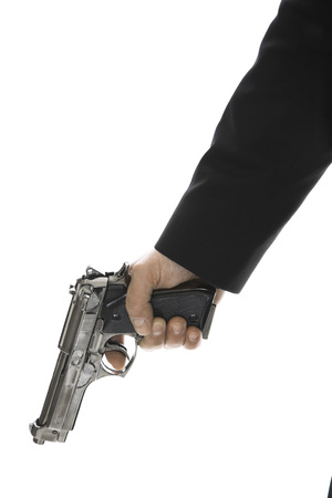Young Man Holding Hand Gun, Close-Up