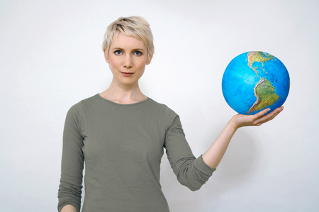 Woman Holding Earth Ball In Hand, Close-Up LANG_EVOIMAGES