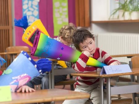 in low spirits: Children (4-7) In Classroom, Holding School Cones LANG_EVOIMAGES