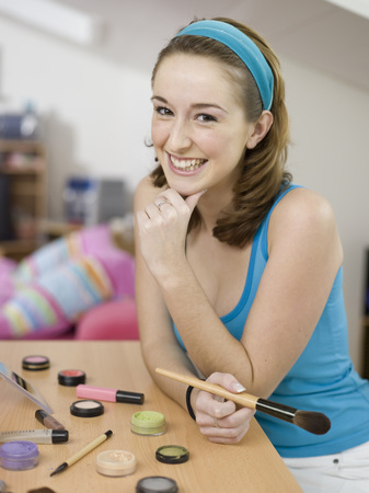Young Woman Holding Cosmetic Brush, Portrait