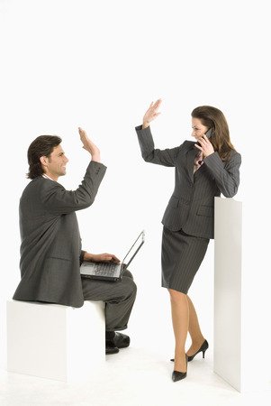 Business Colleagues Giving High Five, Smiling